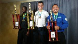 2016 gold medalists (left to right): Desmonde Ellington (AGTO large-size company division), Braulio Lopez (WRO), and Alfredo Calva (AGTO regular-size company division).